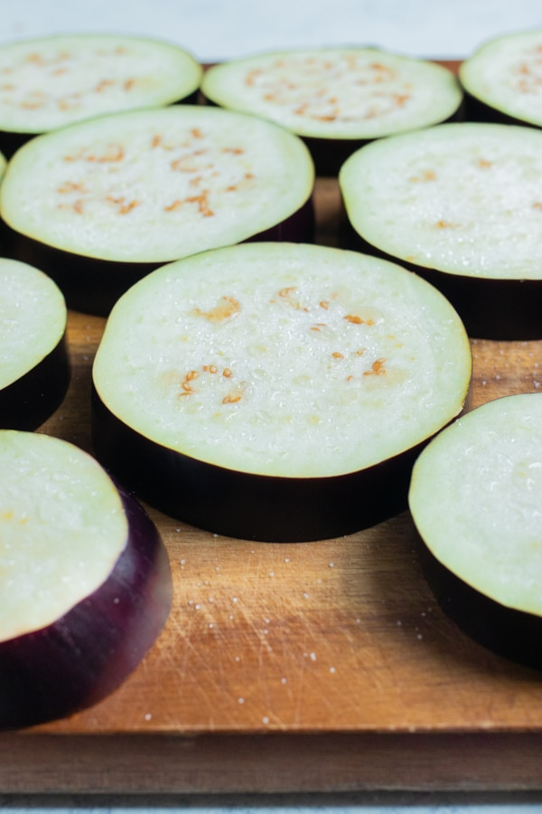 Salt is added to the raw eggplant.