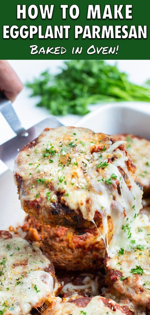 A spatula is used to serve the eggplant parmesan.