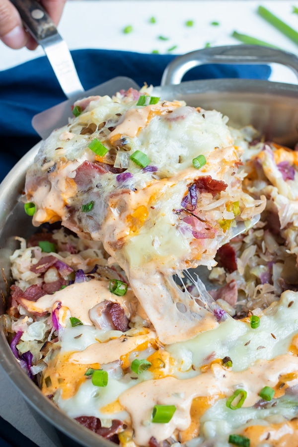 Keto-friendly Reuben in a bowl is dished with a spatula.
