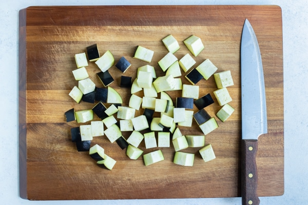 The cubed eggplant is prepared for the air fryer.