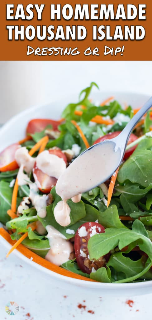 A metal spoon is used to drizzle homemade thousand island dressing.