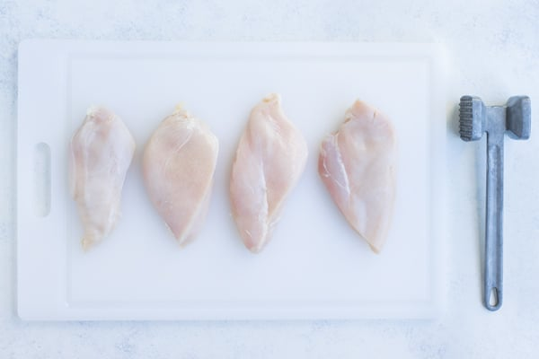 Chicken breasts are pounded into 1 inch thick.