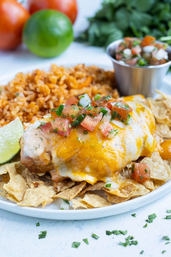 Fiesta lime chicken is placed on top of tortilla chips.