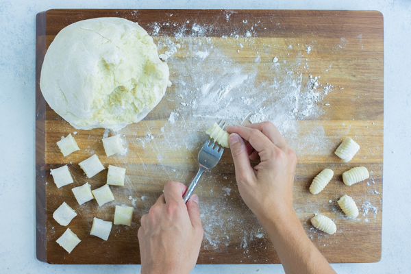 Gnocchi is formed and shaped using the back side of a fork.