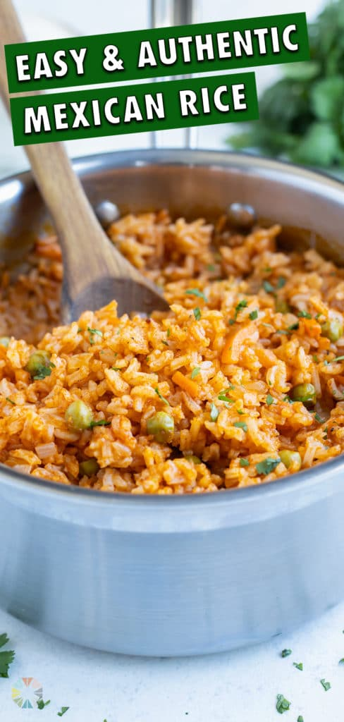 Mexican rice is dished from a metal pot on the counter.