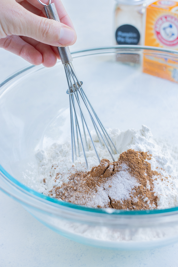 All the dry ingredients are combined in a glass bowl.