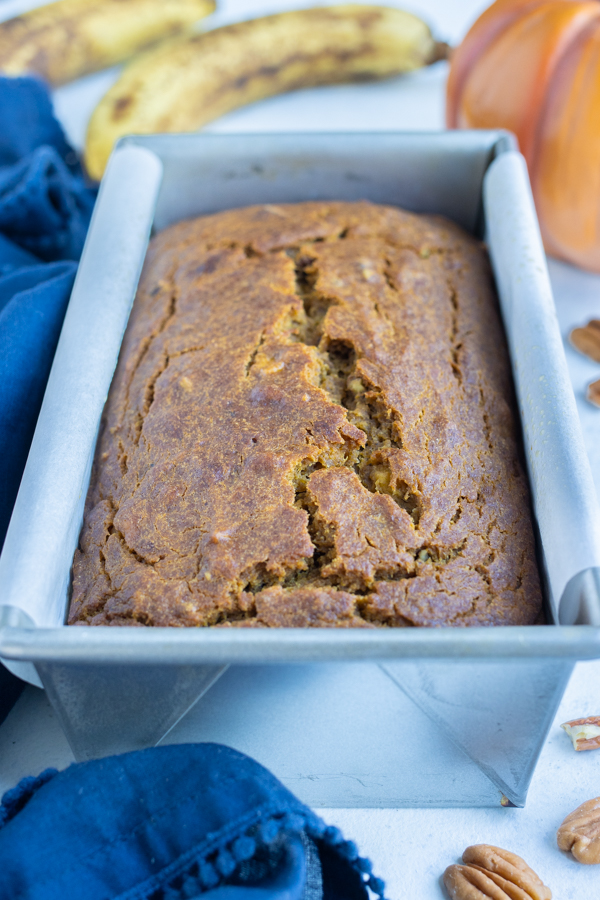 A loaf of pumpkin banana bread is shown on the counter.