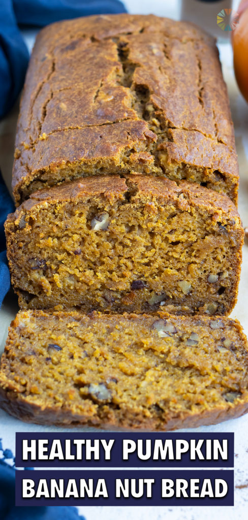 Bananas, pecans, and a pumpkin are set on the counter next to a loaf of pumpkin bread.