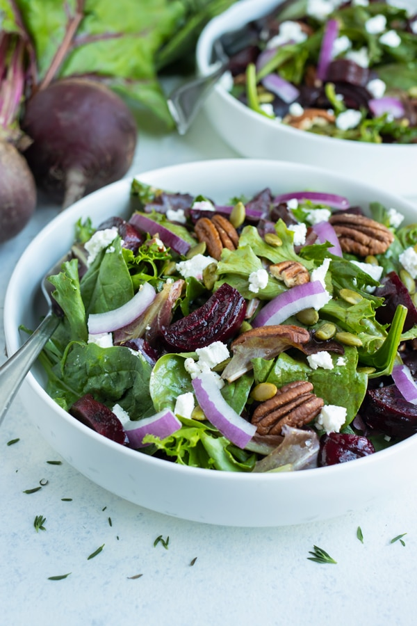 Two salads are served for a low-carb, healthy salad.
