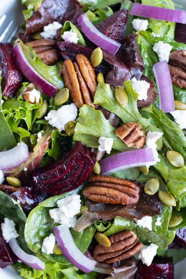 Roasted beets and goat cheese are added to this warm fall salad.