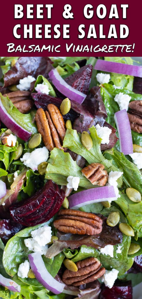 Spinach salad is loaded with nuts, onions, goat cheese, and roasted beets.