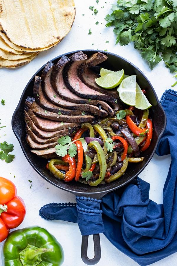 Flank steak fajita is served for a low-carb dinner recipe.